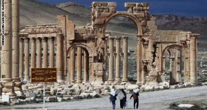 A picture taken on March 14, 2014 shows Syrian citizens walking in the ancient oasis city of Palmyra, 215 kilometres northeast of Damascus. From the 1st to the 2nd century, the art and architecture of Palmyra, standing at the crossroads of several civilizations, married Graeco-Roman techniques with local traditions and Persian influences. AFP PHOTO/JOSEPH EID        (Photo credit should read JOSEPH EID/AFP/Getty Images)